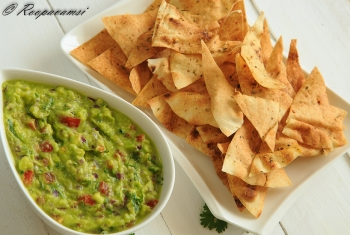 painting titled Guacamole dip with Pita bread chips