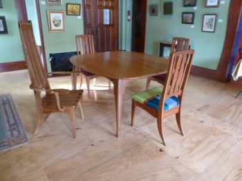 wood painting titled Marc Dining Set